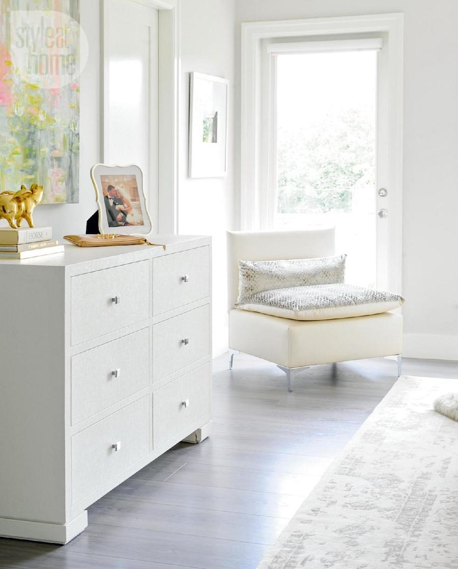 White dresser, sitting chair and overdyed rug