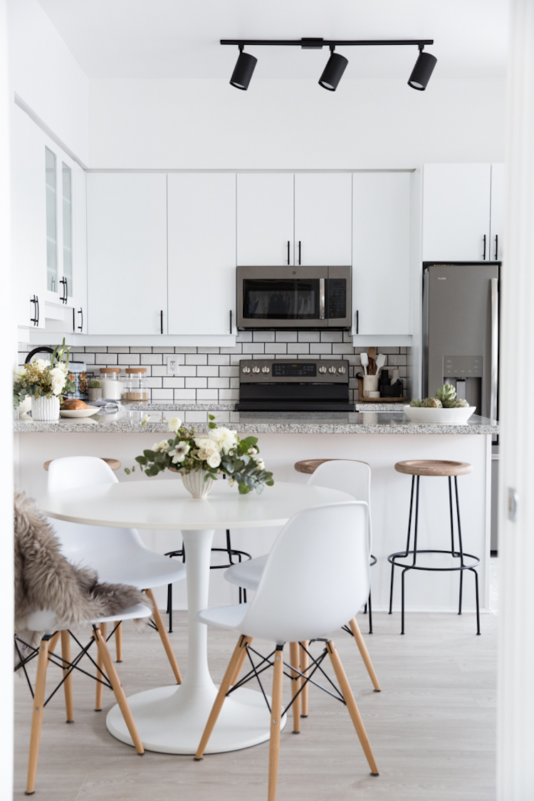 White eames chairs in dining room