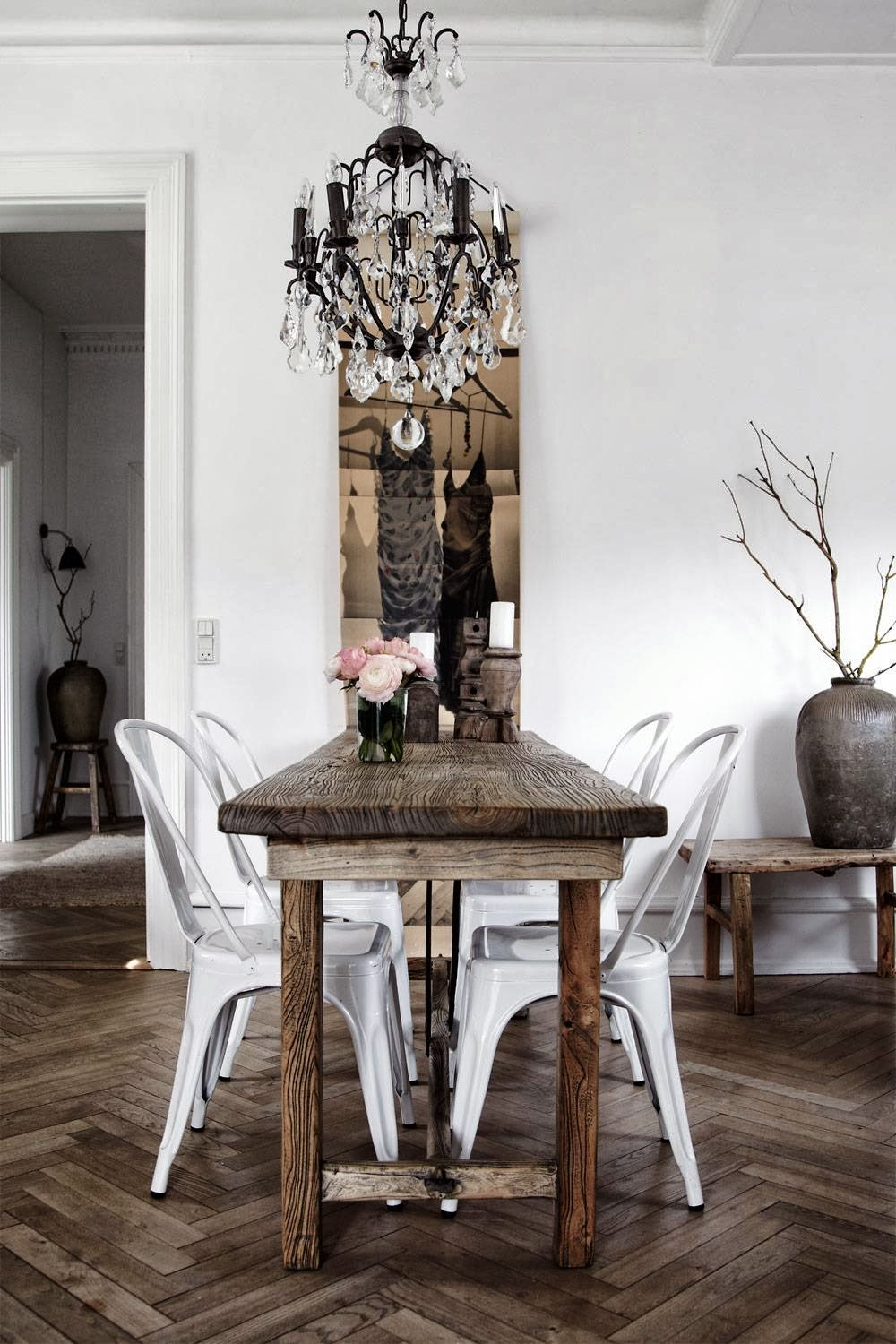 White folix chairs with wood dining table