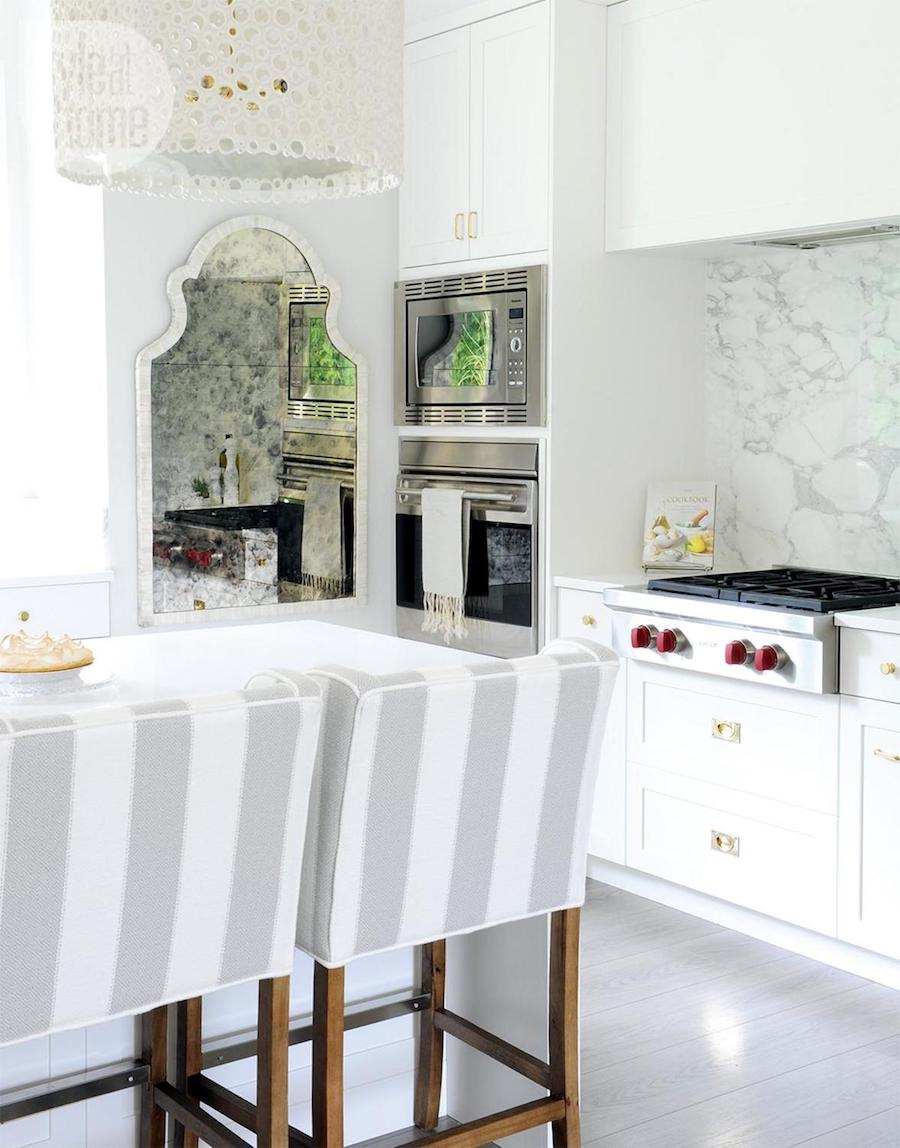 White kitchen with grey and white striped barstools