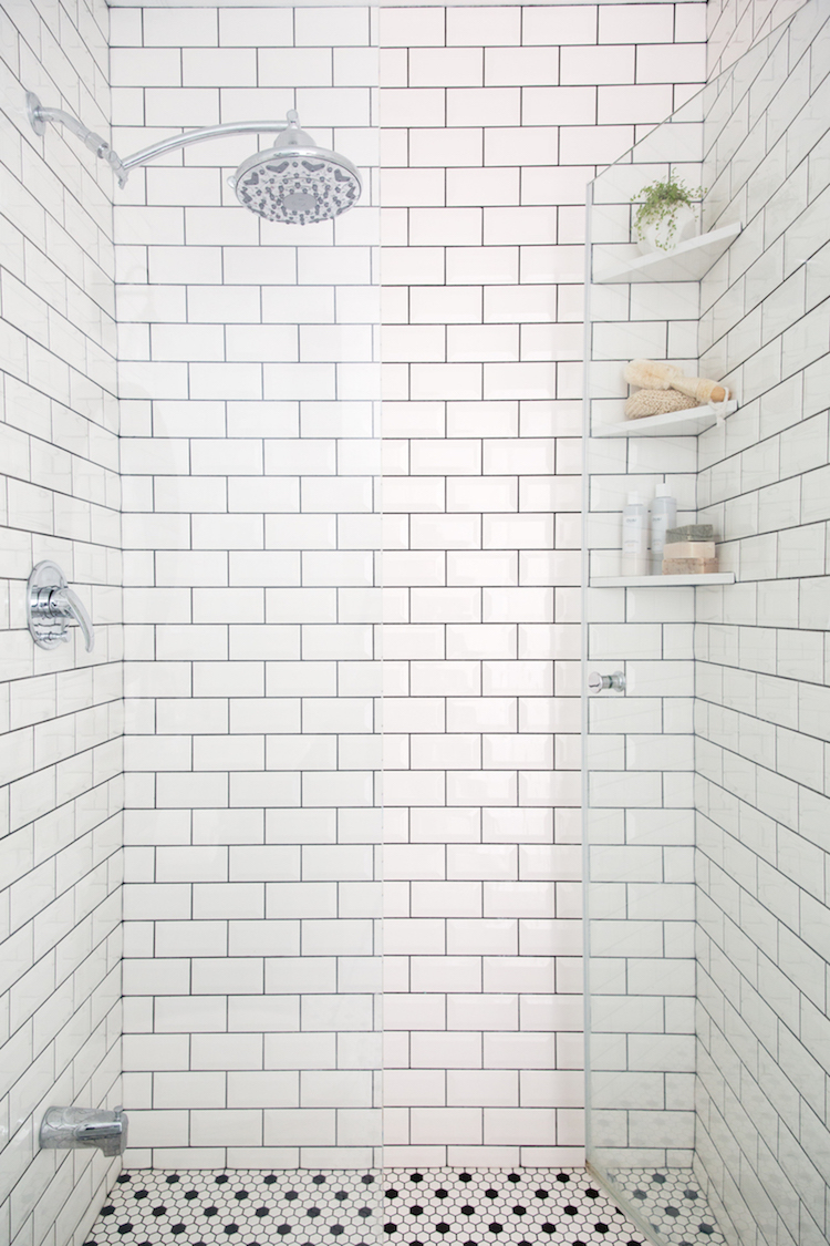 White subway tile shower with black grout