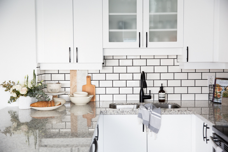 White subway tiles black grout kitchen backsplash