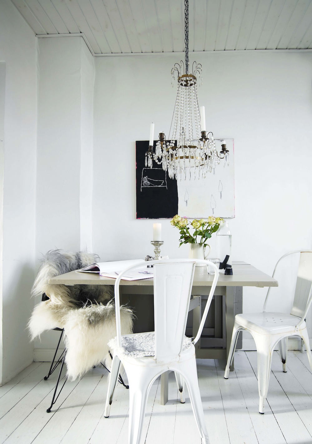 White tolix chairs with crystal chandelier