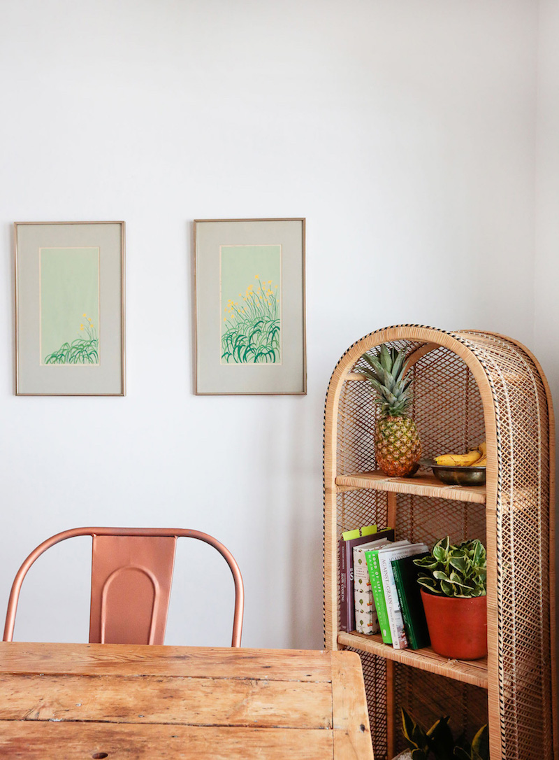 Wicker bookcase in dining room