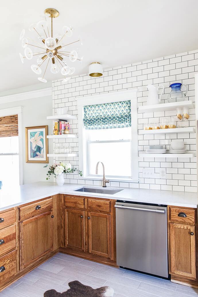 Wood kitchen with sputnik chandelier via Glitter Guide