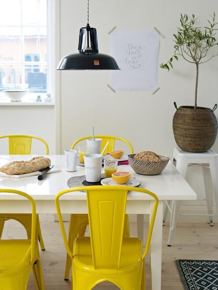 Yellow tolix chairs in the dining room