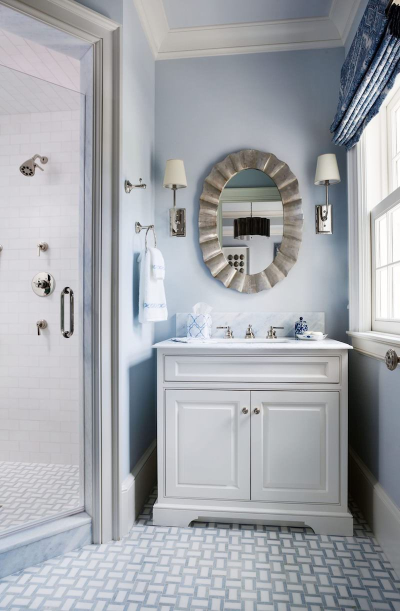Baby blue bathroom with tiled floors