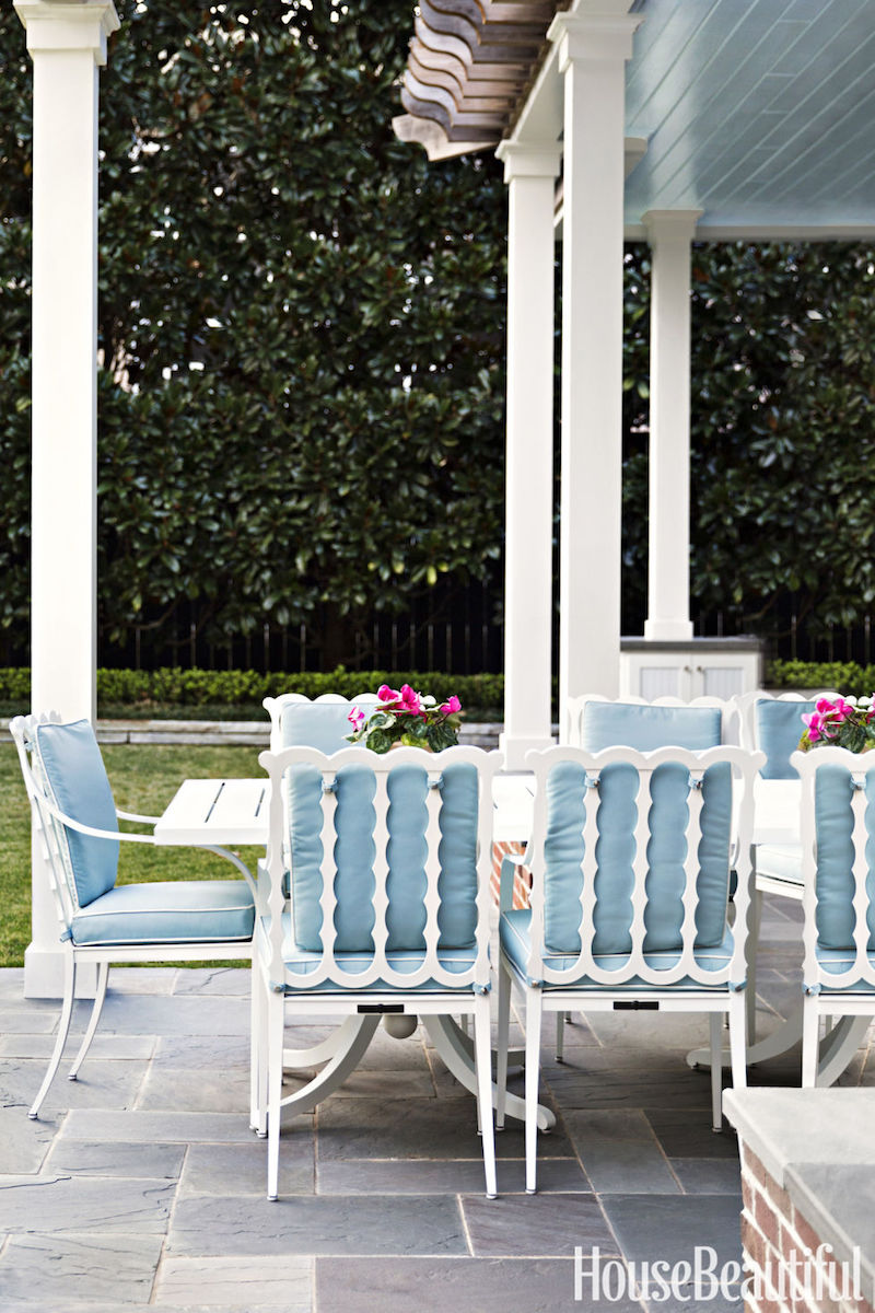 Baby blue chairs around stone patio via House Beautiful