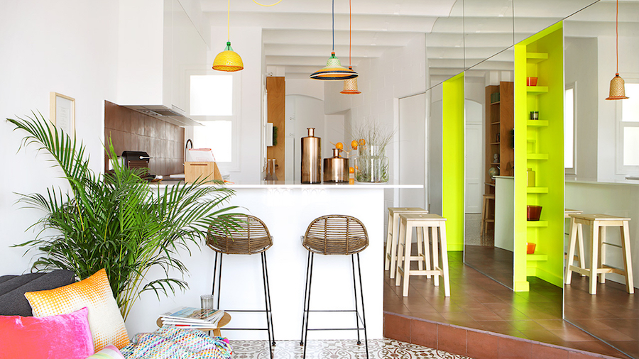 Barcelona kitchen with brown bar stools and neon yellow wall