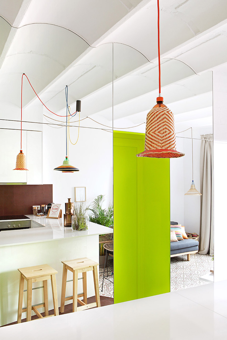 Barcelona kitchen with neon yellow accent wall