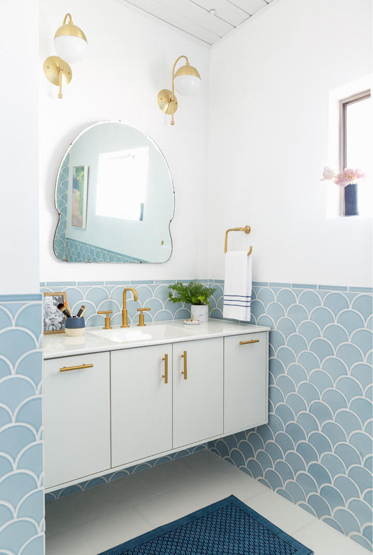 Bathroom with half wall of blue scallop tiling