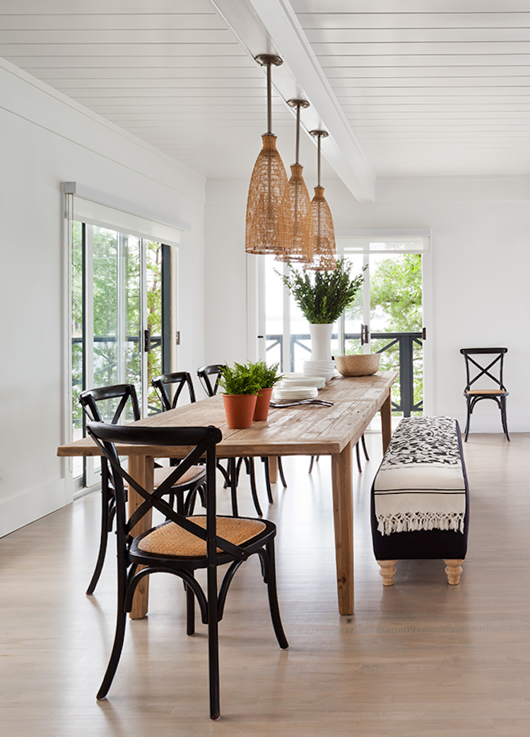 Black x-back chairs in dining room via House & Home Lloyd Ralphs Design