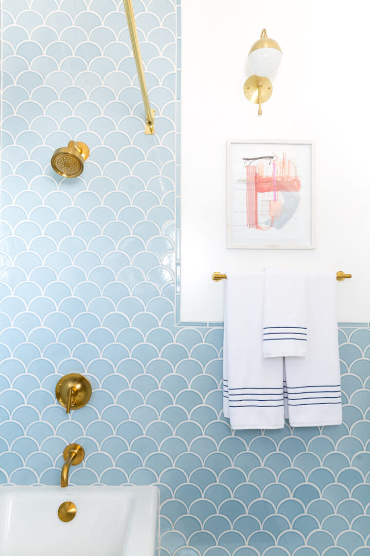 Blue Scallop Tiling in Bathroom with Gold Brass Fixtures