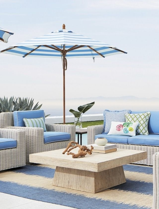 Blue cushion seating on outdoor patio with striped umbrella