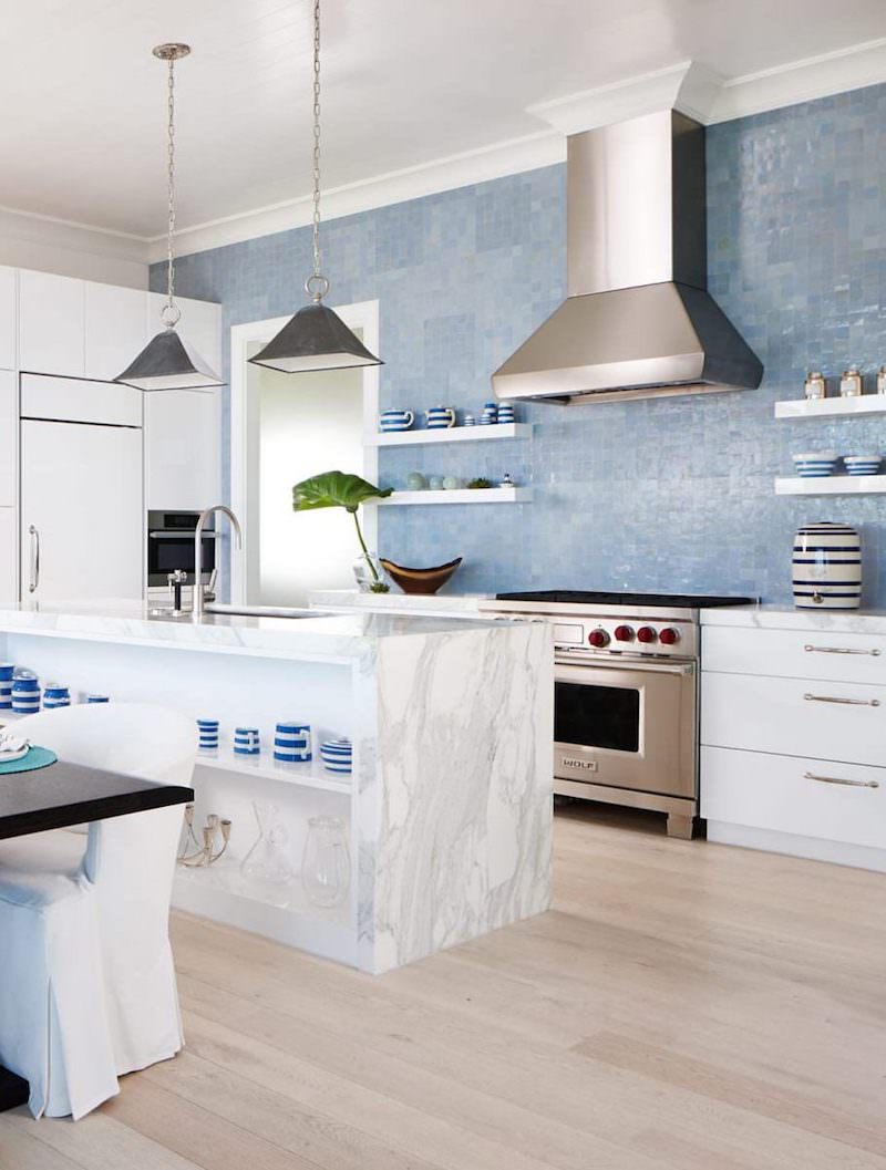 Blue tile backsplash in kitchen with marble island