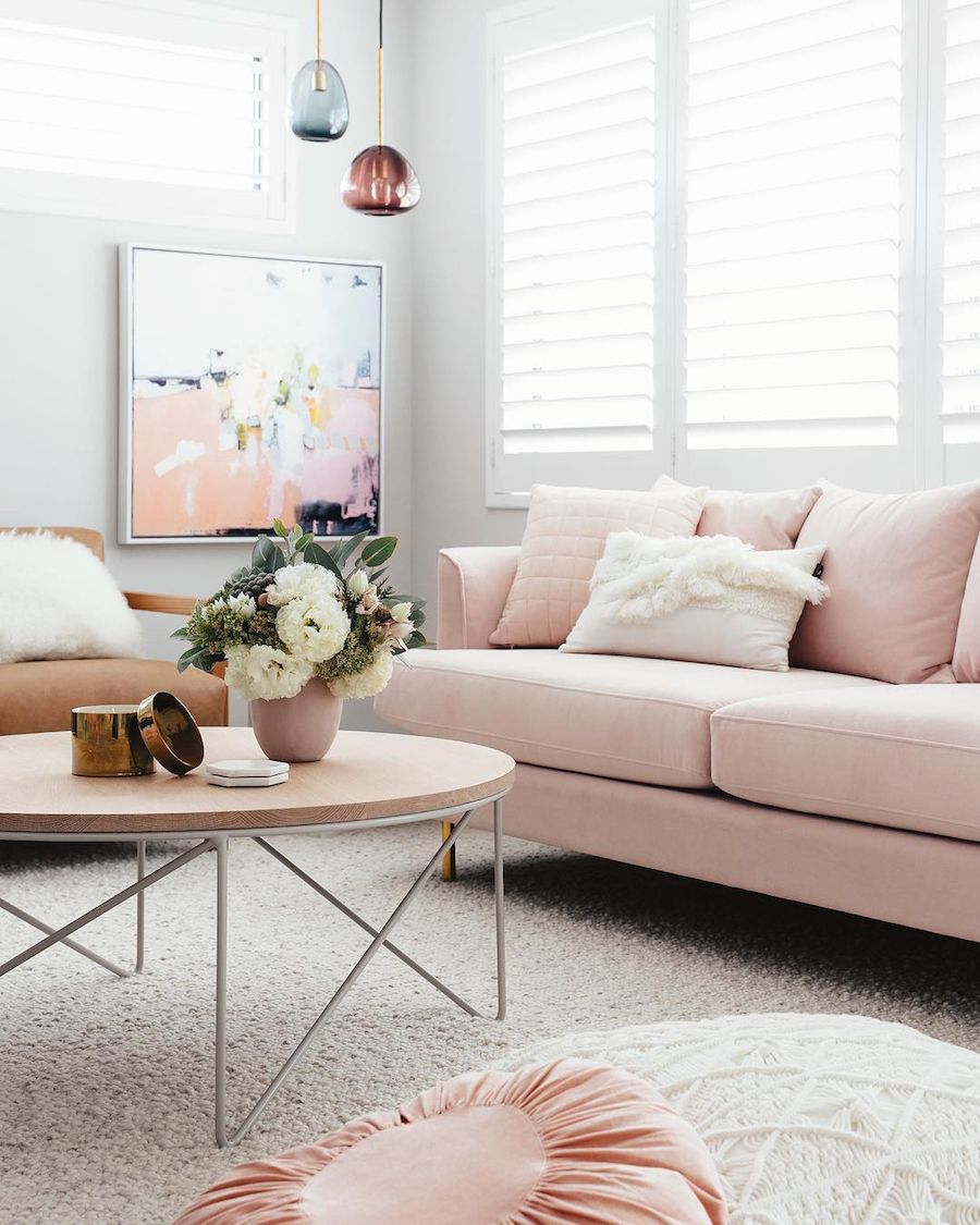 Blush pink sofa with abstract art via Jenni Farr