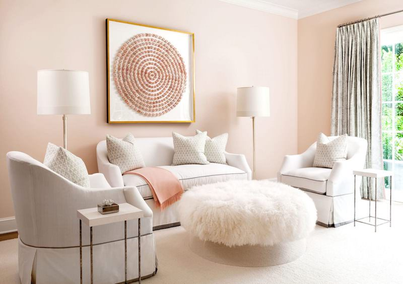 Blush pink wall living room with white sofas and pink art