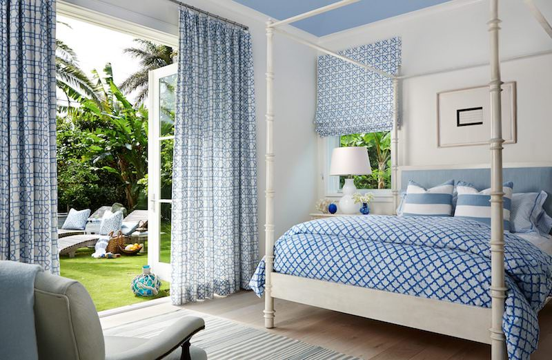 Bright bedroom with patterned blues and doors outside