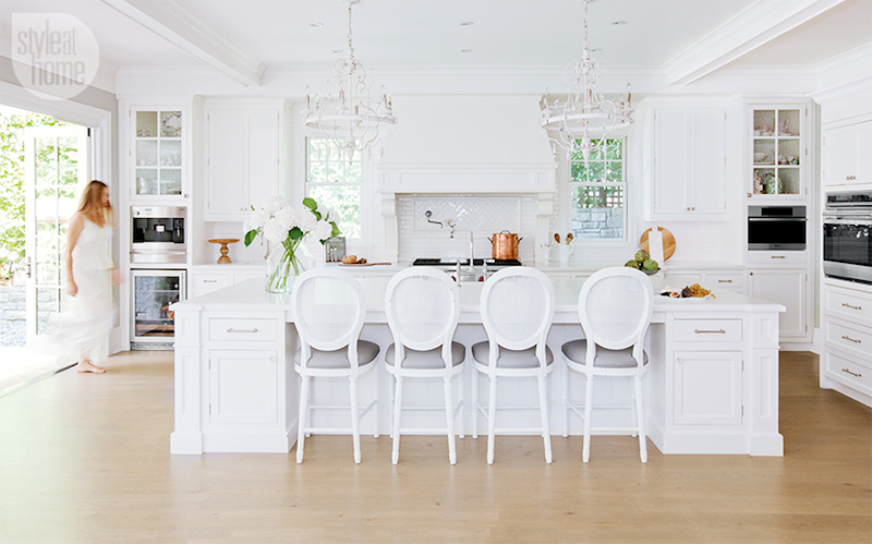 Bright white kitchen with french bar stools