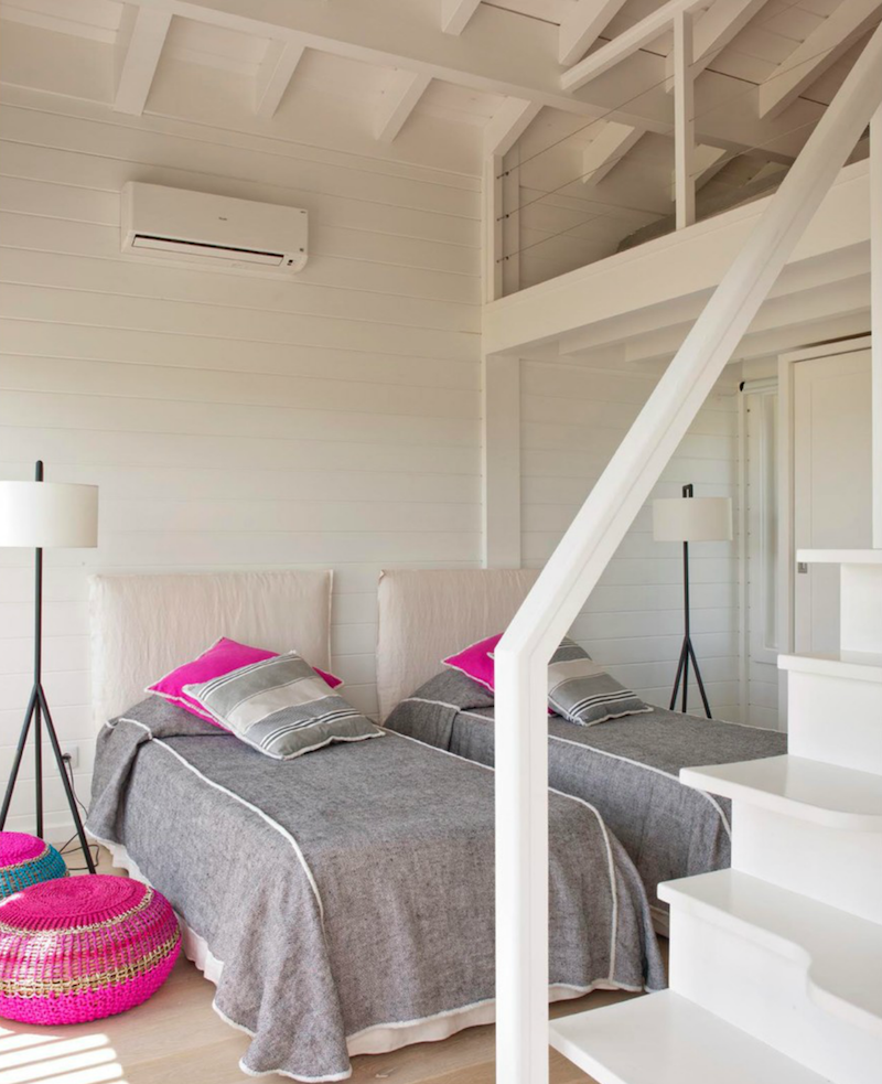 Grey twin beds with hot pink pillows