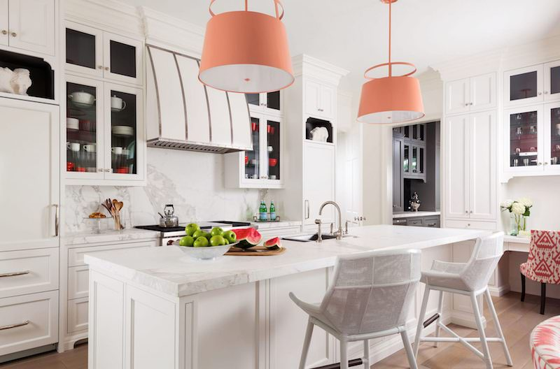 Large peach pendant lights in marble kitchen