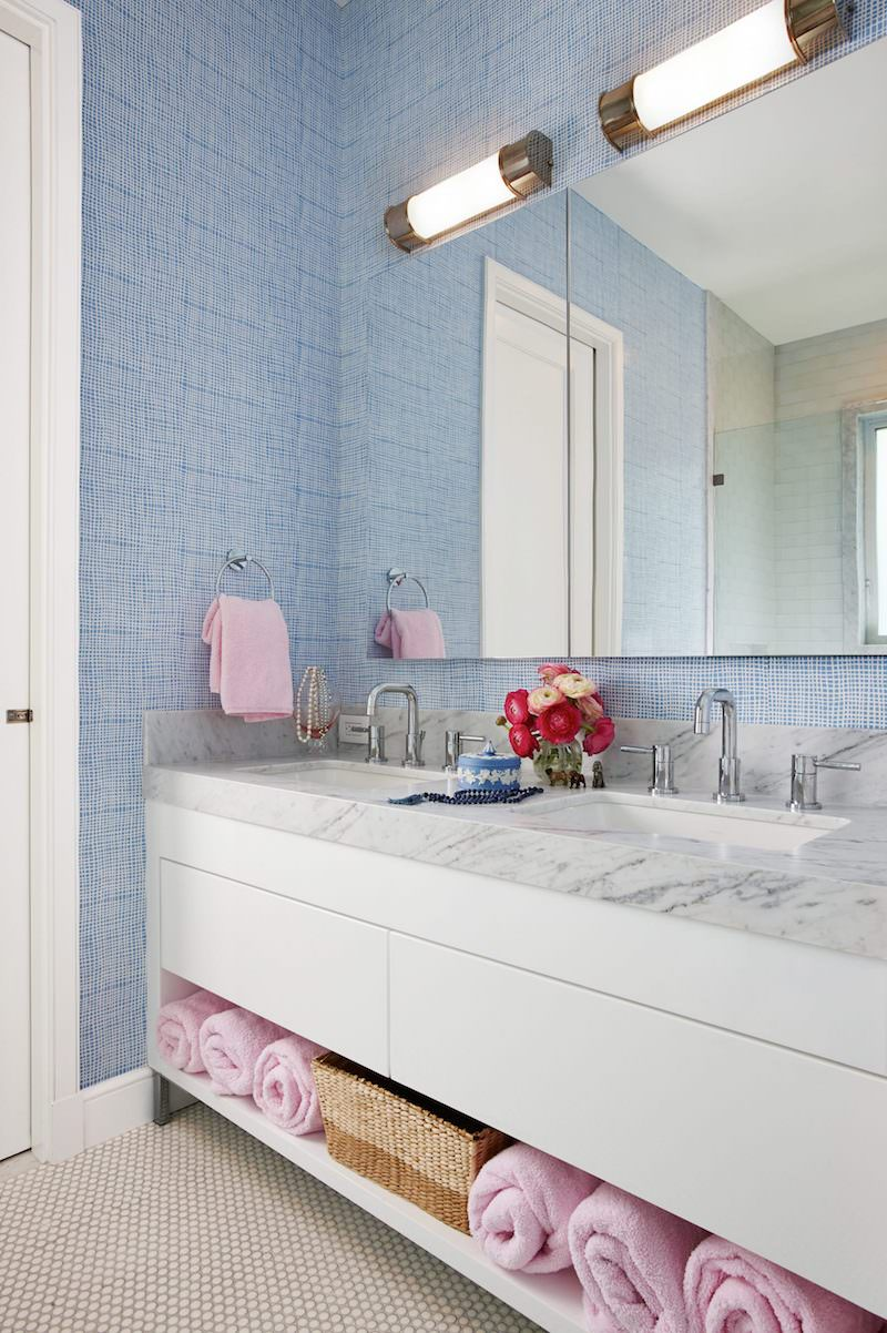 Marble bathroom sink with blue wallpaper