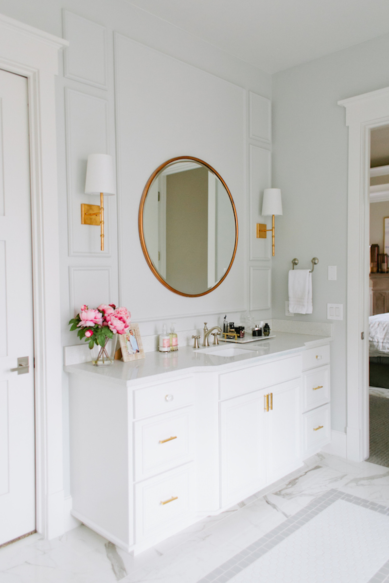 A Serene Marble Bathroom With a Freestanding White Tub