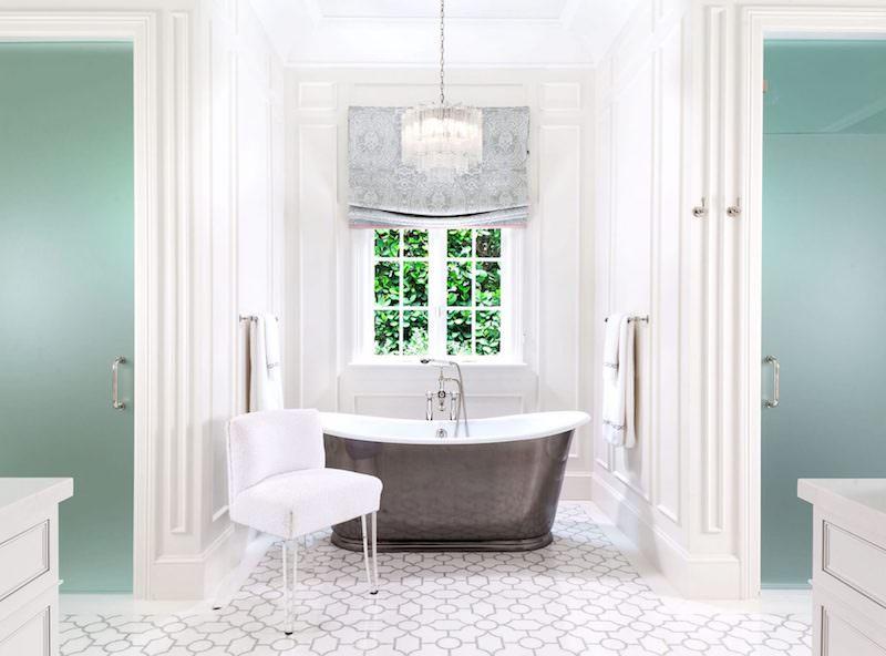 Metal freestanding tub in turquoise wall bathroom