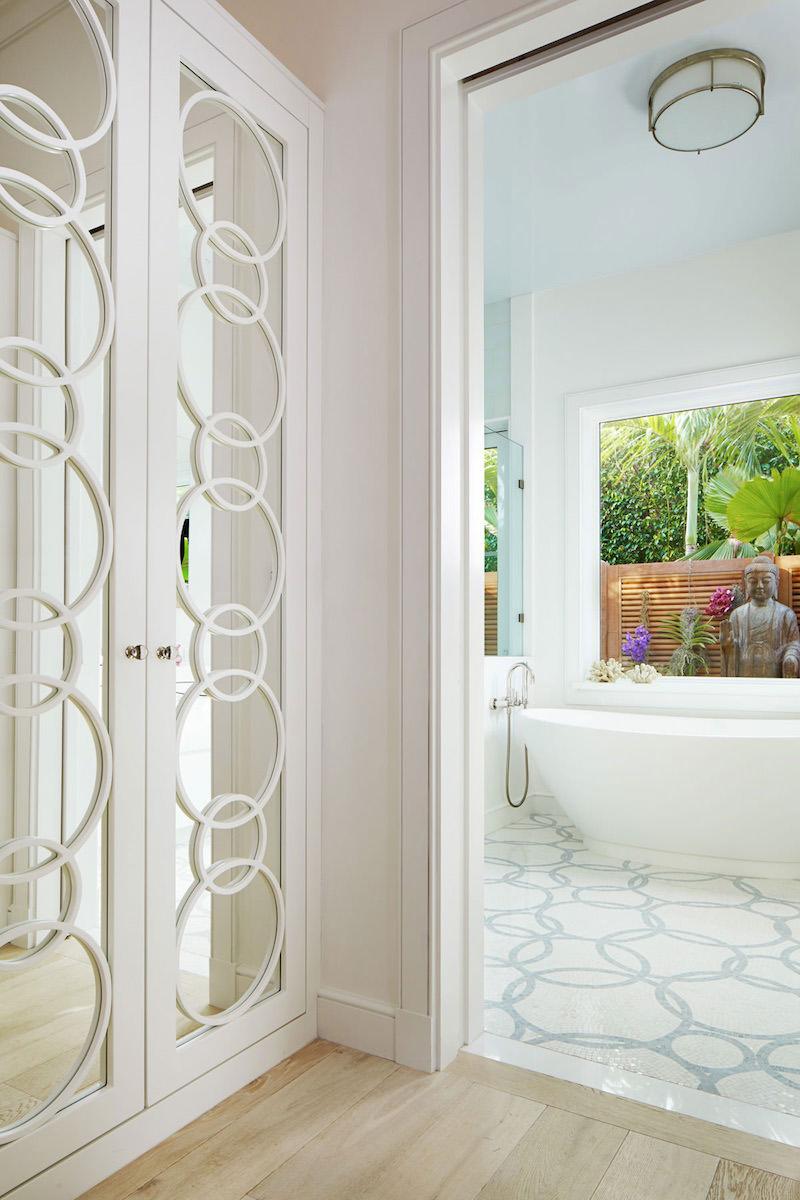 Mirrored closet doors near bathroom