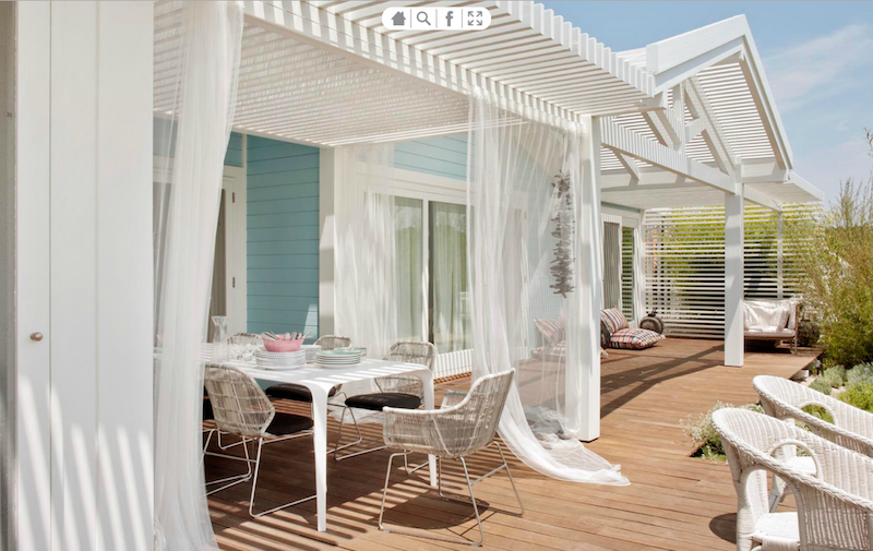 Outdoor deck with sheer white flowing curtains