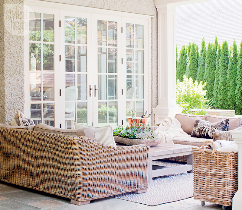Outdoor patio space with brown couch