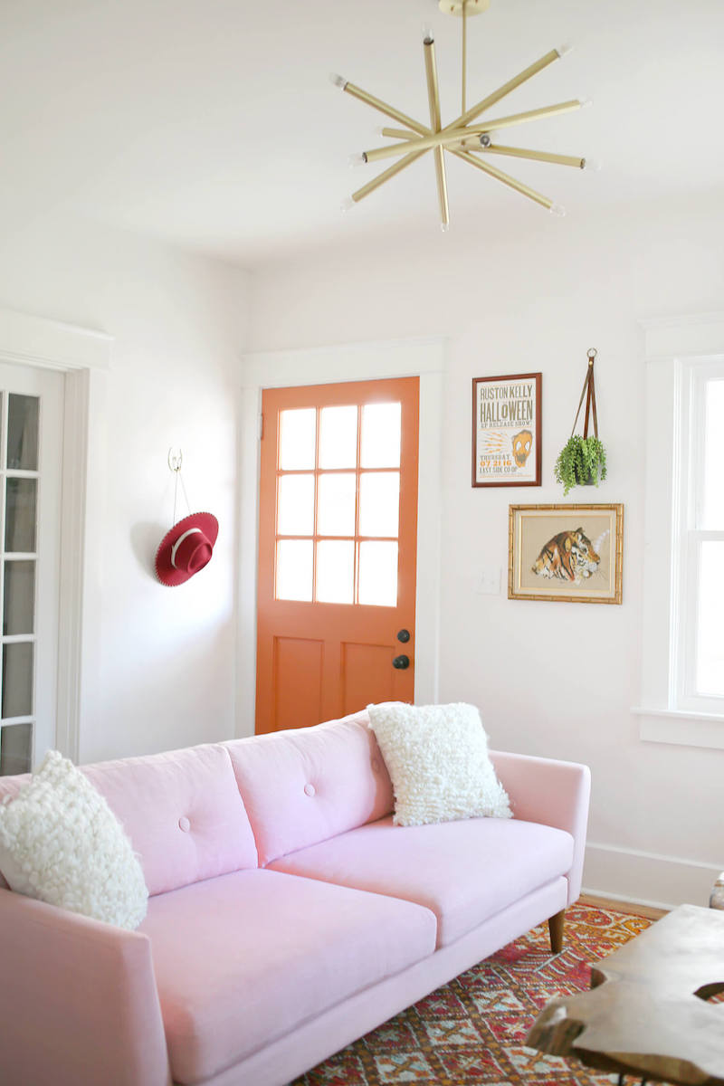 Pale pink sofa with starburst light