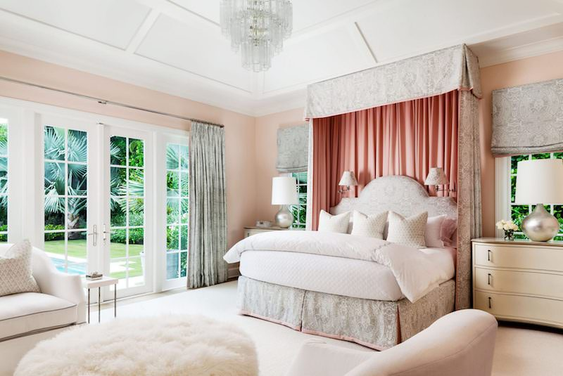 Pink bedroom with canopy curtains