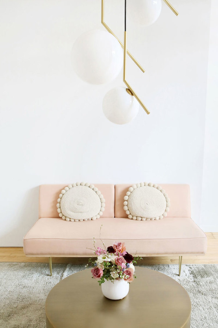 Pink blush sofa with neutral pillows
