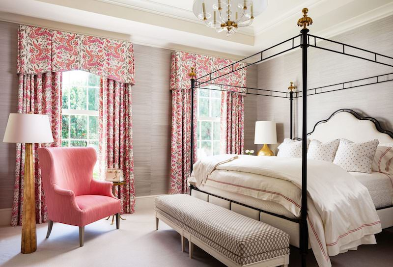 Pink curtains in bedroom with beige walls
