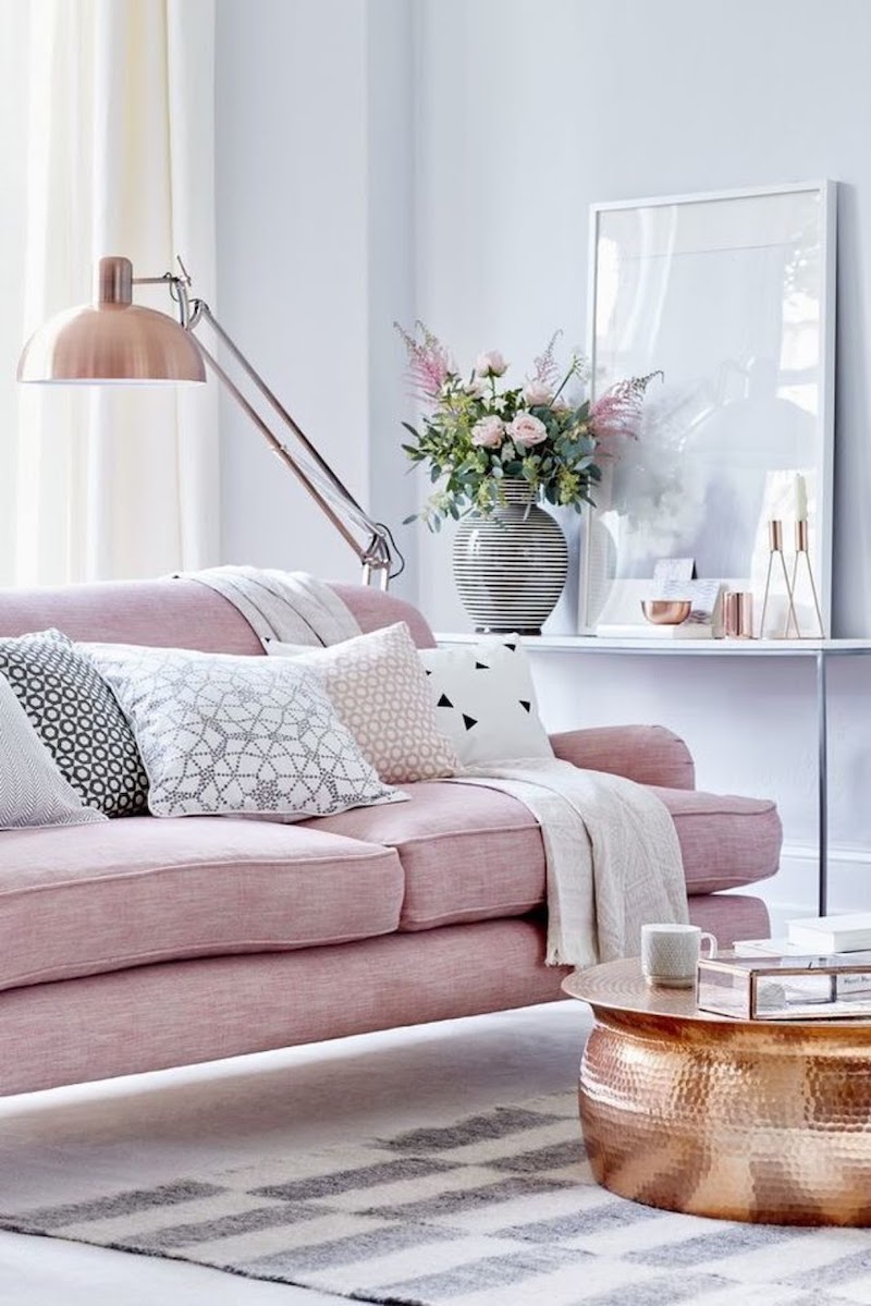 Pink sofa with copper marble table