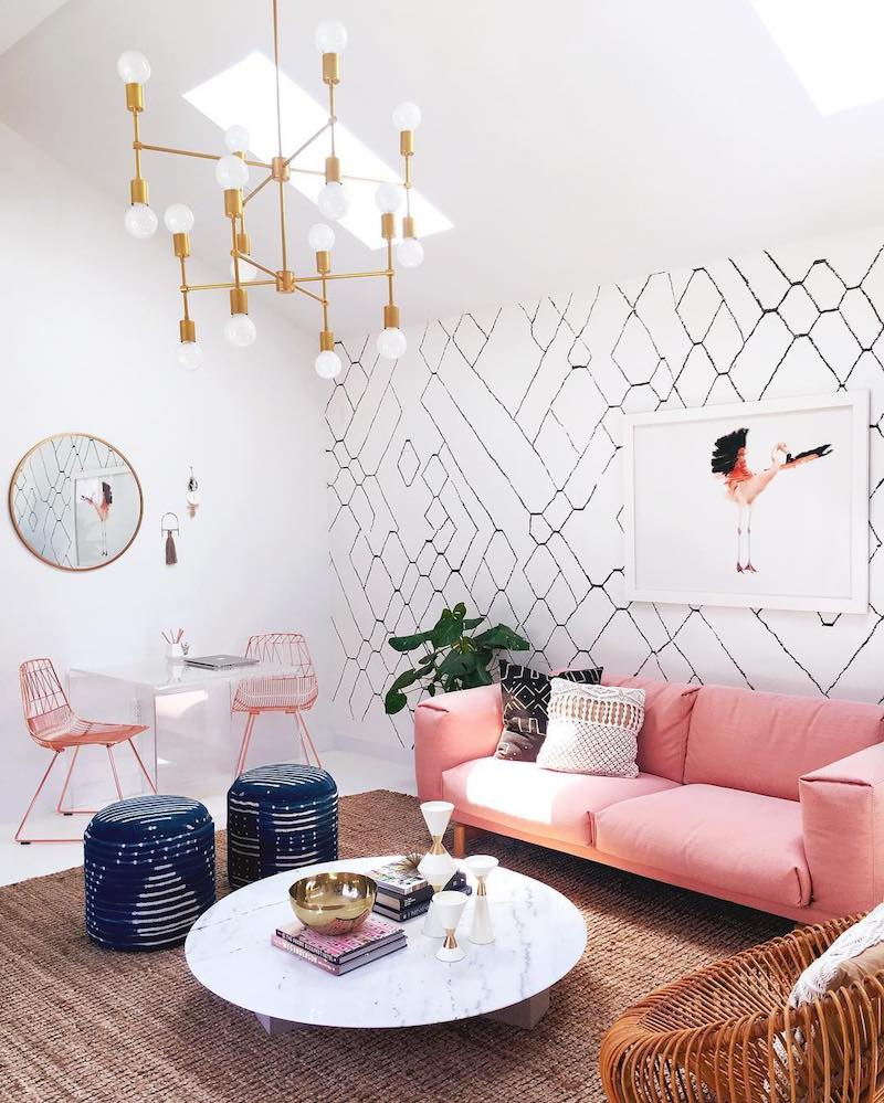 Pink sofa with marble coffee table and branch gold lighting