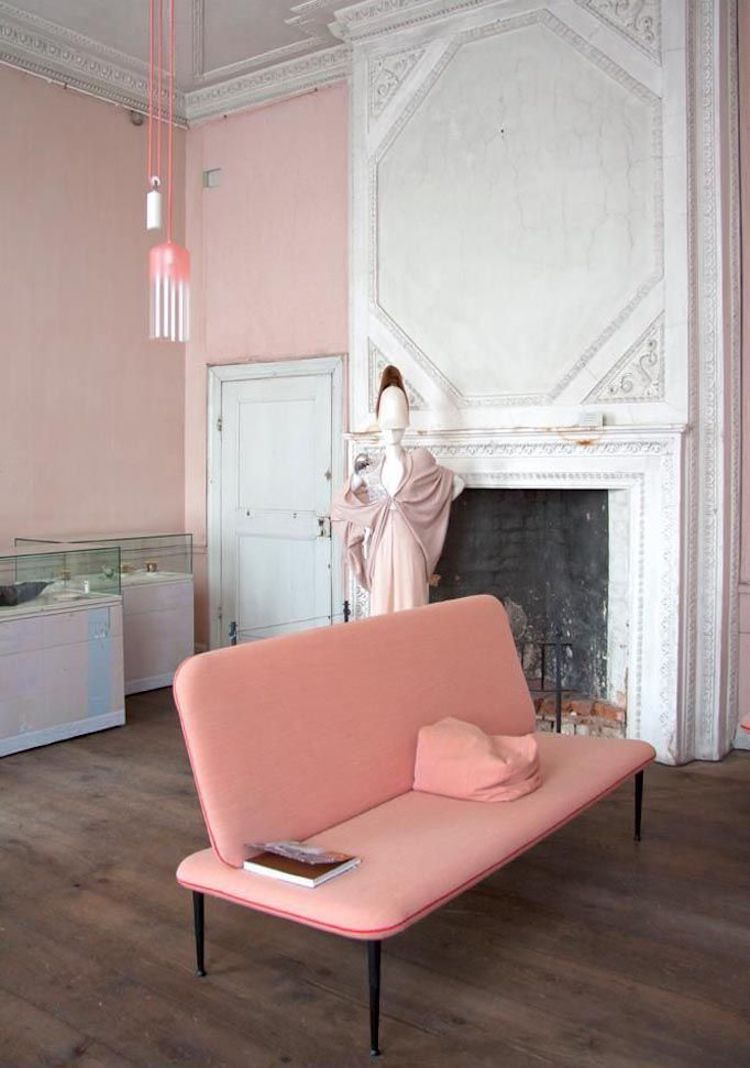 Pink sofa with pink gradient pendant light and white millwork