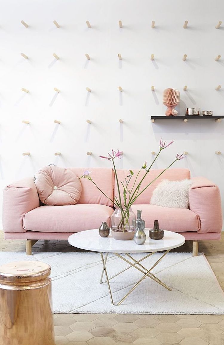 Plush pink couch with white marble coffee table