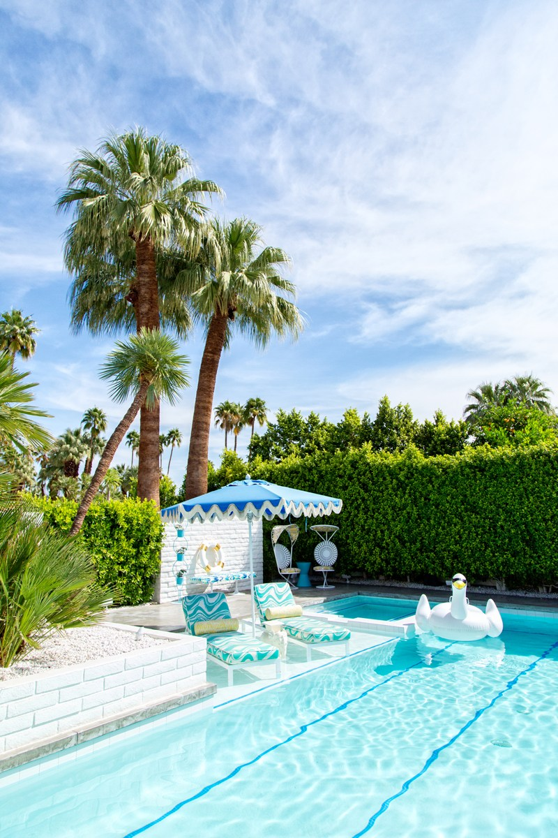 Pool with turquoise lounge chairs and fringe umbrellas