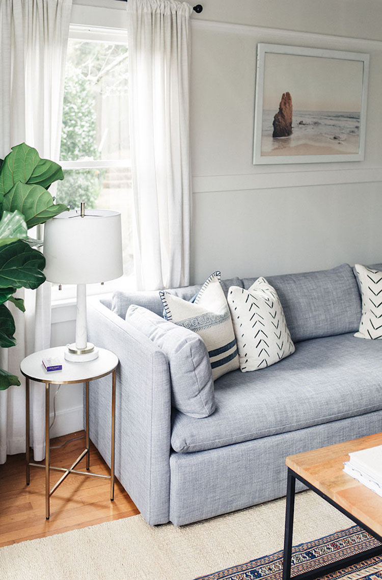 Shelter Sofa and white marble side table via GG