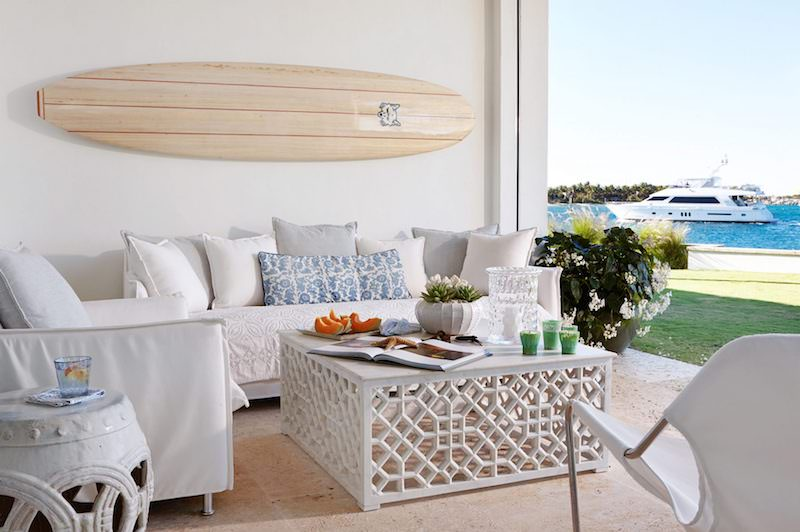 Surfboard on wall in living room open to outside
