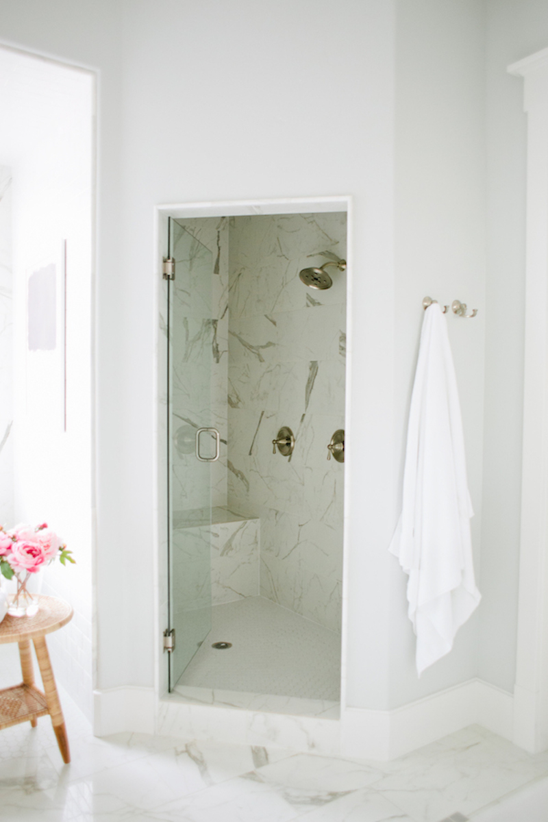 Walk-in shower with marble walls