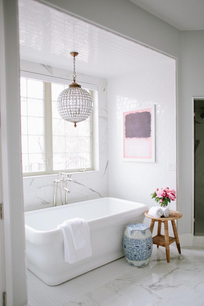 White bathtub with blue garden stool