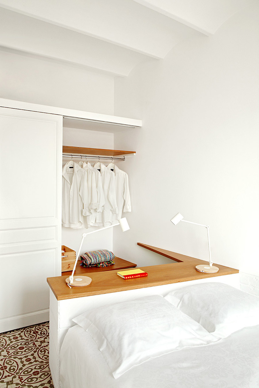 White bed with small closet inside functional barcelona apt