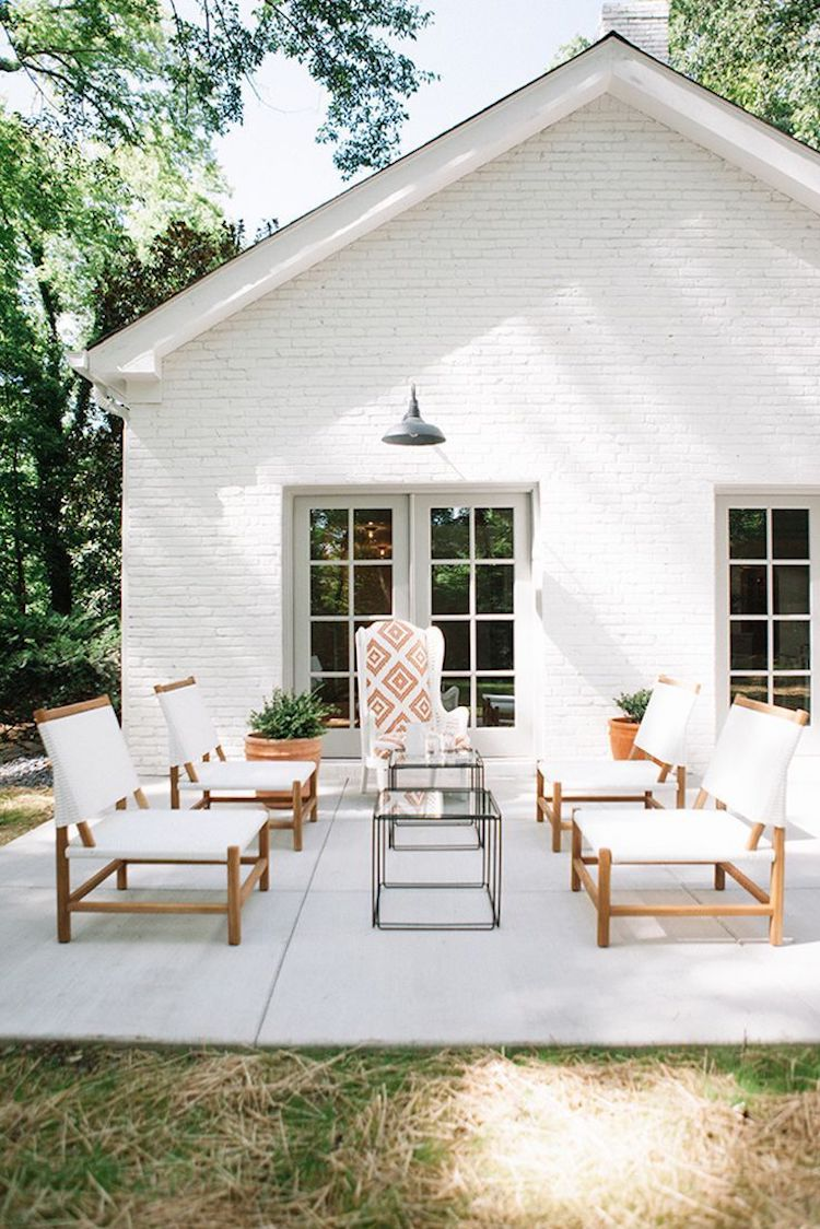 White chairs on a grey stone patio