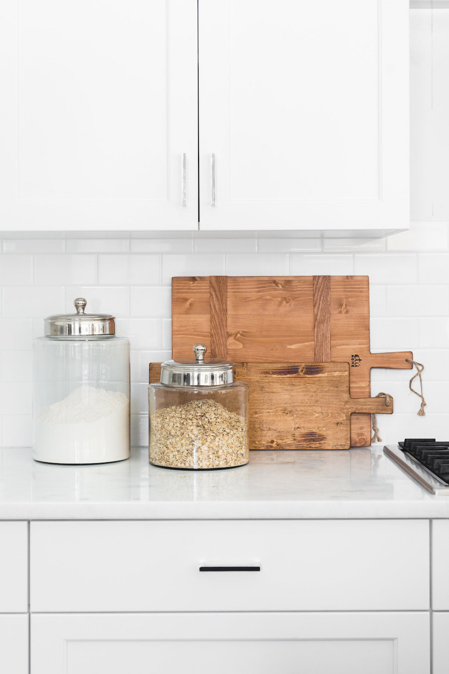 Wood Cutting Board in Marble Kitchen