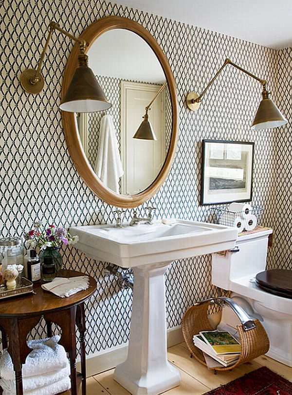 Bathroom with tiling on wall and large brass swing arm sconces