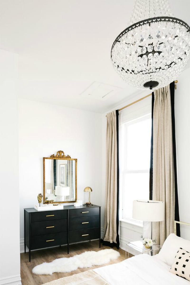 Black wide dresser with gold handles in Bedroom