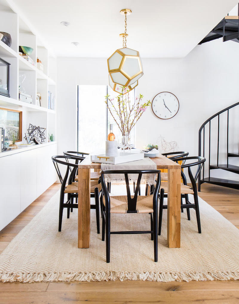 Black wishbone chairs in neutral dining room via Emily Henderson